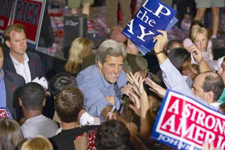 handshakes: Senator John Kerry shakes hands with supporters at the Thomas Mack Center at UNLV, Las Vegas, NV Editorial