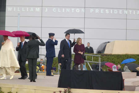 Heads of state along with former VP Al Gore and wife Tipper Gore walk on stage during the official opening ceremony of the Clinton Presidential Library November 18, 2004 in Little Rock, AK