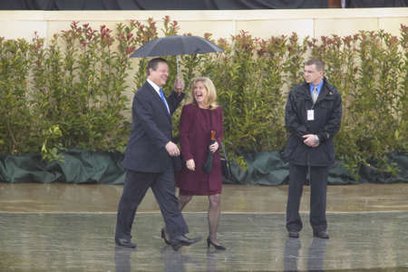 VP Al Gore and Tipper Gore walk along stage during the official opening ceremony of the Clinton Presidential Library November 18, 2004 in Little Rock, AK