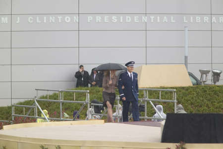 escorted: Chelsea Clinton is escorted to the stage during the official opening ceremony of the Clinton Presidential Library November 18, 2004 in Little Rock, AK Editorial