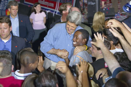 mack: Senator John Kerry embraces African-American child at the Thomas Mack Center at UNLV, Las Vegas, NV Editorial
