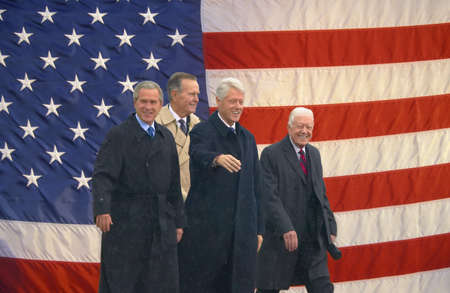 Photo mosaic of American flag and former U.S. President Bill Clinton, President George W. Bush, former presidents Jimmy Carter and George H. W. Bush at the opening ceremony of the Clinton Presidential Library November 18, 2004 in Little Rock, AK