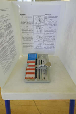 voting: Close-up of a voting booth and ballot machine, CA
