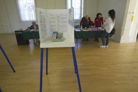 polling: Election volunteers and voting booths in a polling place, CA