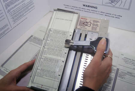 voting booth: Close-up of a voting booth and ballot machine with ballot , CA