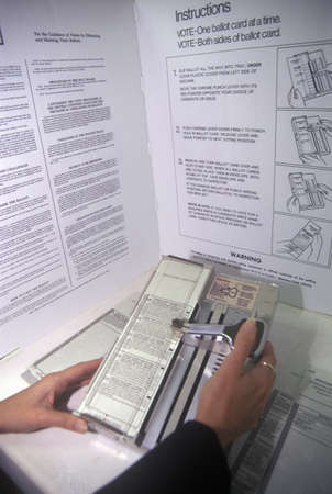 voting: Close-up of a voting booth and ballot machine with ballot , CA