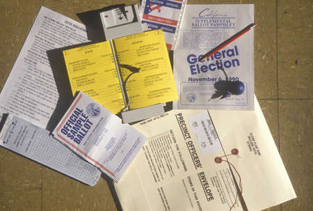 voting booth: Close-up of a voting booth with ballots, ballot machine and election pamphlets, CA