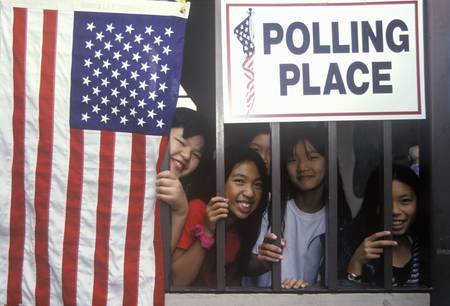 polling: Children at the entrance to a polling place, CA