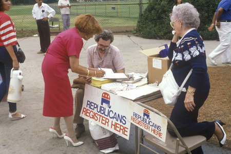 voter: Volunteers working at a table for Republican voter registration, CA
