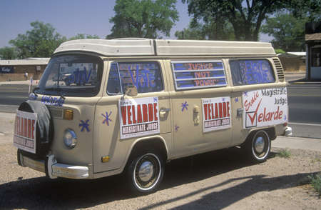 Side view of a van with large campaign sign that reads Velarde - Magistrate Judge, NM