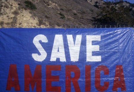 Sign on fence reads Save America