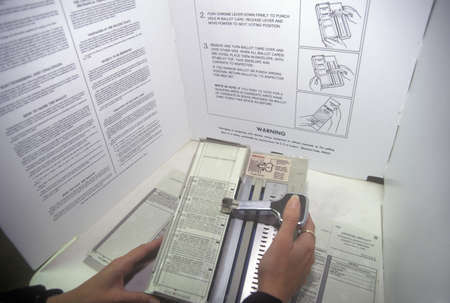 Close-up of a voting booth and ballot machine with ballot , CA