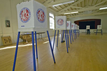 voting: Election volunteers and voting booths in a polling place, CA