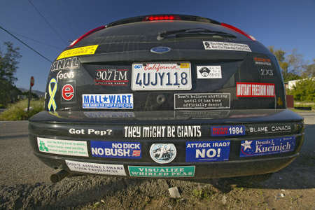 Car with political and social issues bumper stickers in Oak View, California