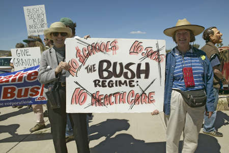 protestor: Protestor in Tucson Arizona of President George W. Bush holding a sign protesting his Health Care plans