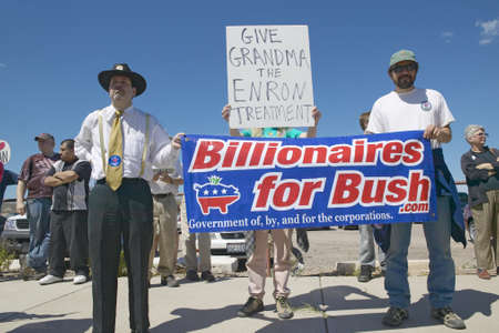 domestic policy: Protestor in Tucson Arizona of President George W. Bush holding a sign proclaiming Billionaires for Bush Editorial