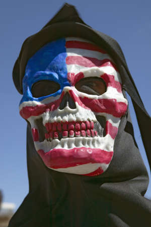 political and social issues: Death mask with an American flag of the grim reaper at George W. Bush and anti-America protest in Tucson, AZ