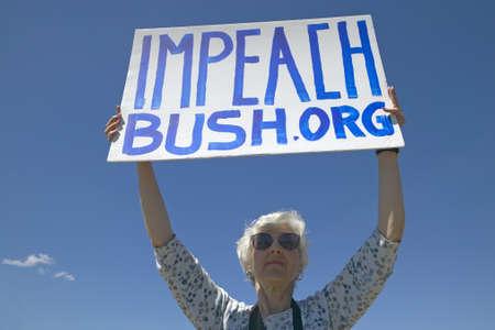 political rally: Political rally with a sign reading Impeach Bush in Tucson, AZ