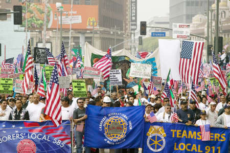 political and social issues: Union worker banners in front of hundreds of thousands of immigrants participating in march for Immigrants and Mexicans protesting against Illegal Immigration reform by U.S. Congress, Los Angeles, CA, May 1, 2006