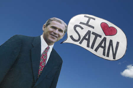 political and social issues: Picture of anti-Bush political rally in Tucson, AZ with a sign saying President George W. Bush Loves Satan in Tucson, AZ Editorial
