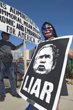 political and social issues: Three protestors in Tucson, AZ of President George W. Bush is holding a sign proclaiming Bush is a Liar regarding the Iraq War Editorial