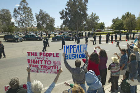 political and social issues: Presidential Motorcade with President George W. Bush past anti-Bush political rally with signs that read Impeach Bush in Tucson, AZ