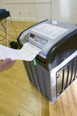 electronic voting: Voter inserts completed ballot for Congressional election, November 2006, into an electronic scanner in Ojai, Ventura County, California