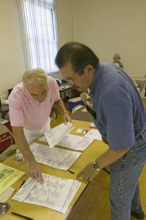 Election worker helps explains ballot for Congressional election, November 2006, in Ojai, Ventura County, California