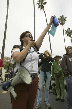 political and social issues: A woman protester with a loud speaker gestures with her arm to the crowd at an anti-Iraq War protest march in Santa Barbara, California on March 17, 2007 Editorial
