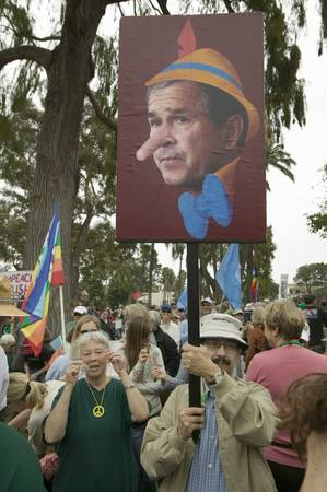 political and social issues: Depiction of President George W. Bush as Pinocchio painted on a sign at an anti-Iraq War protest march in Santa Barbara, California on March 17, 2007