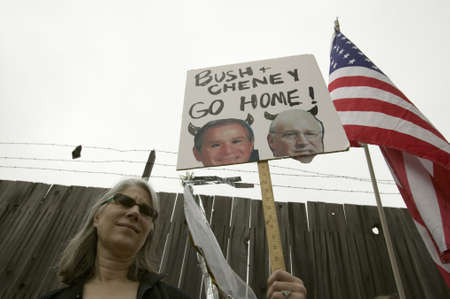 vp: A sign shows President Bush and VP Cheney as the devil with the US Flag at an anti-Iraq War protest march in Santa Barbara, California on March 17, 2007 Editorial