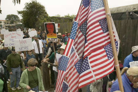 Protesters march with US Flag against President George W. Bush and the Iraq war at an anti-Iraq War protest march in Santa Barbara, California on March 17, 2007