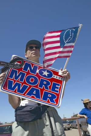 no war: Picture of anti-Bush political rally in Tucson, AZ with sign reading No More War