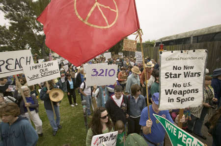 Protesters march with peace flag against President George W. Bush and the Iraq war at an anti-Iraq War protest march in Santa Barbara, California on March 17, 2007