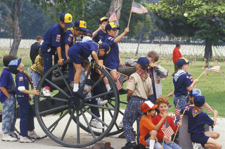 scouts: Cub Scouts Playing on Cannon, Veterans National Cemetery, Los Angeles, California Editorial