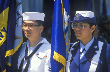 Sailor and Female Soldier Holding Flags, United States Army Parade, Chicago, Illinois