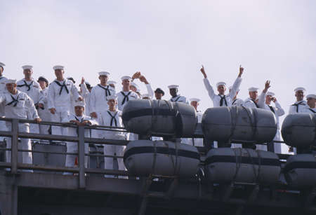 homecoming: American Sailors Waving From Deck of Aircraft Carrier