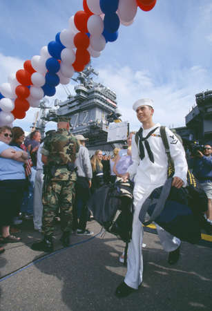 homecoming: American Sailor Returning Home From Sea
