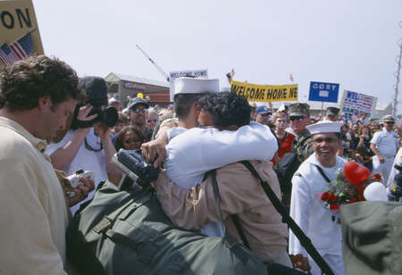homecoming: American Sailor Hugging Family Member After Returning Home From Sea Editorial