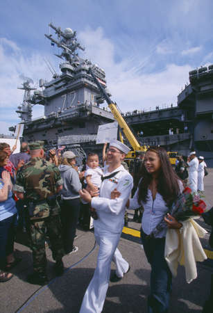 American Sailor with Wife and Child After Returning Home From Sea