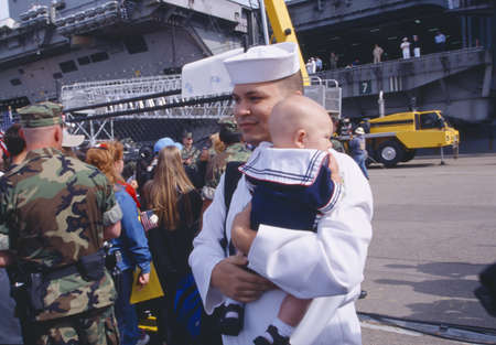homecoming: American Sailor Holding Baby After Returning Home From Sea