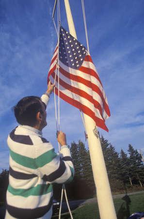 free me: Man Raising American Flag, Maine
