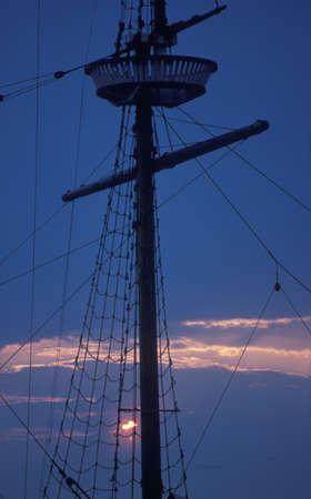 schooner: Mast of a schooner at dusk