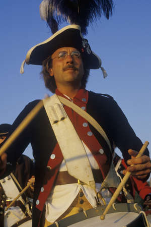 Close up of man playing drum during American Revolutionary war reenactment