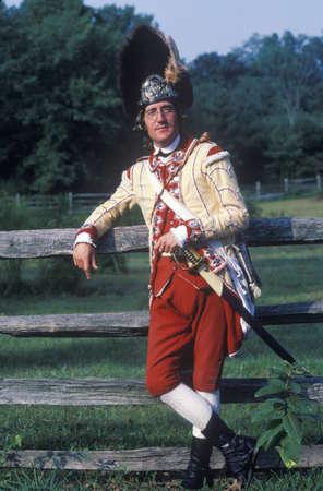 american revolution: Participant posing as a British Army Officer during American Revolution reenactment