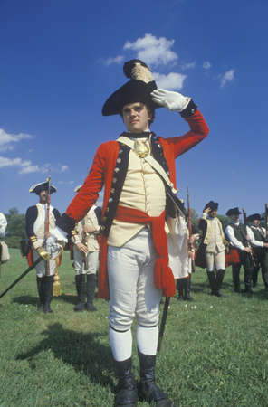 british army: Participant posing as a British Army Officer during American Revolution reenactment