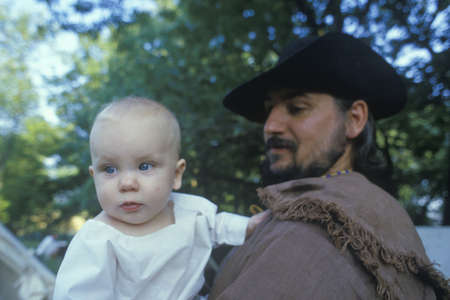 follower: Camp follower with baby during historical Reenactment of Continental Army, Revolutionary War at Daniel Boon Homestead