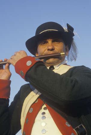 revolutionary war: Close up of man playing fife during American Revolutionary war reenactment