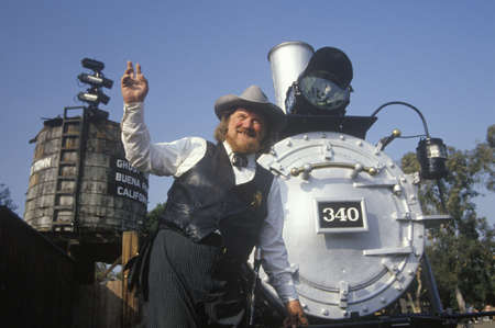 period costume: U.S. Marshall in period costume posing with Steam engine at Knotts Berry Farm, Buena Park, CA