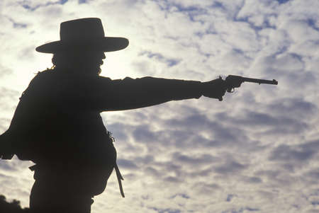Silhouette of Cowboy aiming pistol